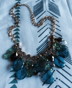 Slate grey, forest green, and turquoise jewels.