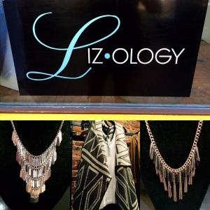 From left: Silver plated multi-tier necklace, reversible cream & tan draped vest, fringed chain necklace with grey & black bead accents.